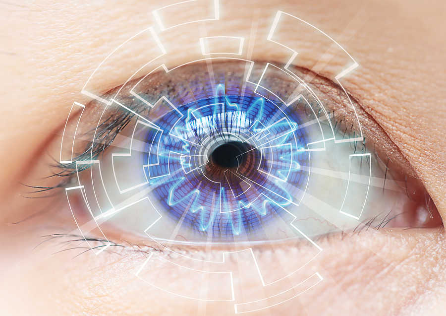 Close-up Of Woman's Blue Eye. High Technologies In The Futuristi